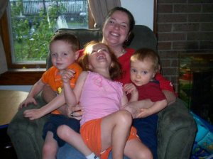 Burke, Maggie, and Logan on Mommy lap