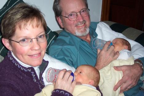 Nana and Grandpa feeding the twins